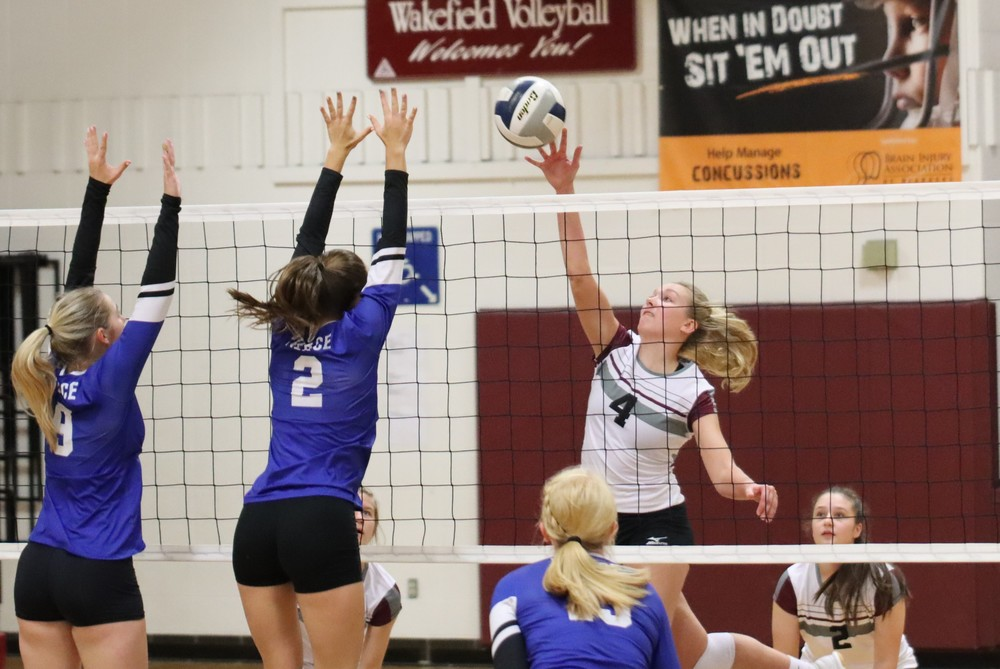 Lady Trojans sweep triangular, host tournament