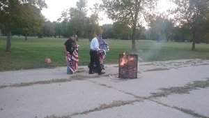 Flag Burning Ceremony Held