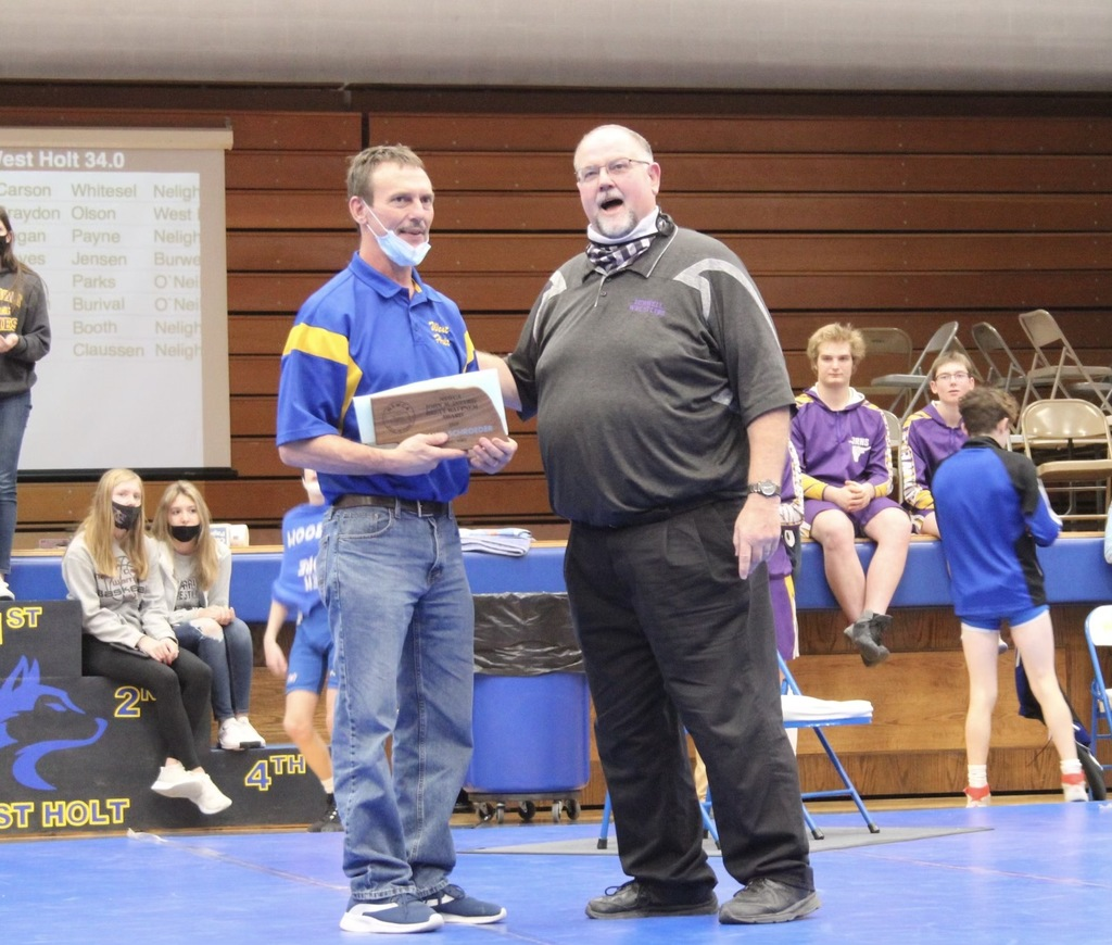 West Holt wrestling Coach Randy Schroeder was presented and award by NSWCA Board Member Mike Max from Burwell.	Courtesy Photo