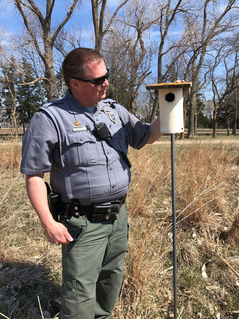 Conservation Officer Jeff Jones checks a Gilbertson bluebird house at the Weigand Recreation Area