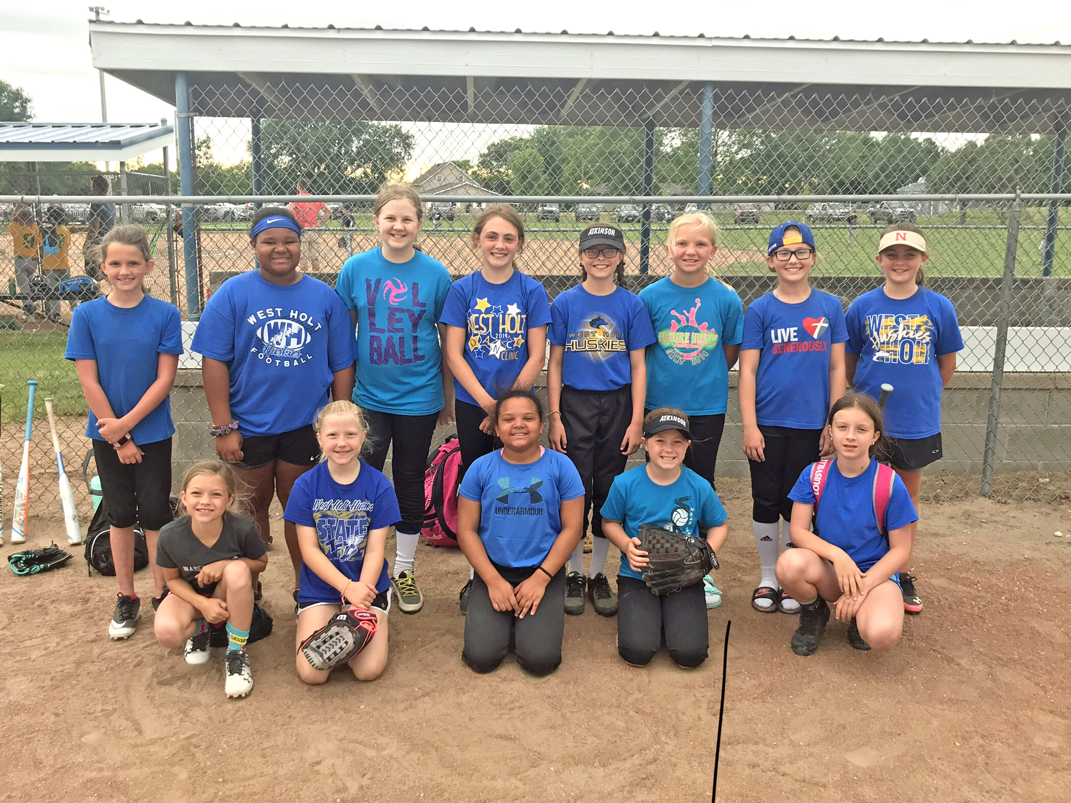 Members of the Atkinson 10 & Under girls' softball team were front, Peyton Skrdla, Eisley Mlady, Shea Jackson, Landri Nemetz, and Olivia Brown; back, Marley Intelkofer, Carleigh Jackson, Taylor Schaaf, Jewel Beckwith, Leah Pistulka, Hannah Hooey, Jordyn Osborne, and Reece Hoffman.	Photo courtesy Kami Hooey